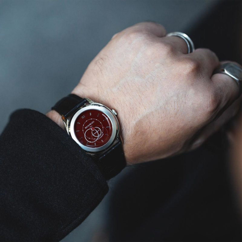 Side view of the Red dial Beaubleu watch with an premium automatic mouvement and handmade leather strap on a wrist